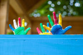 Colorful Children's hands in playhouse — Stock Photo
