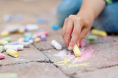 Children's Hand with Colorful chalks — Stock Photo