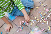Little boy painting on the pavement — Stock Photo