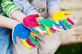 Colorful hands of children playing outside — Stock Photo