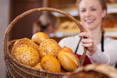 Bakery Worker Holding Bread Basket — Stock Photo