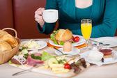 Female having breakfast in a cafe — Stock Photo
