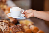 Bakery Worker Serving Cappuccino — Stock Photo