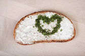 Bread With Cheese Cream Spread And Heart Made Of Herbs — Stock Photo