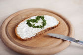 Slice of bread with cheese and a heart — Stock Photo