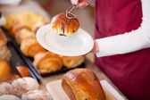 Bakery Worker Keeping Bread In Plate — Stock Photo