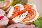Sandwich with tomato and mozzarella — Stock Photo