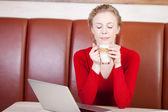 Woman enjoying caffee latte in cafe — Stock Photo