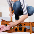 Woman Packing Suitcase On Bed — Stockfoto