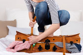 Woman Packing Suitcase On Bed — Foto de Stock