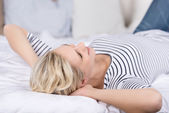 Young Woman Lying On Bed — Stock Photo