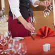 Waitress Arranging Wineglasses On Restaurant Table — Stock Photo
