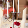 Lit Candles On Holder At Restaurant Table — Stock Photo