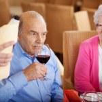 Senior man tasting the wine in restaurant — Stock Photo #26181575