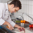 Chef Cutting Meat On Chopping Board — Stock Photo