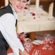 Waitress setting the table — Stock Photo