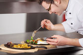 Chef Garnishing Egg Dish With Sauce In Kitchen — Stock Photo