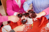 Customers Toasting Wine Glasses At Restaurant Table — Stock Photo