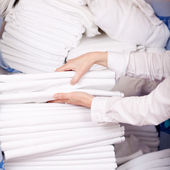 Housekeeper's Hands Stacking Sheet — Stock Photo