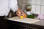 Chef Cutting An Apple On Chopping Board — Stock Photo