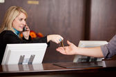 Young Receptionist Giving Room Keys To Customer — Stock Photo