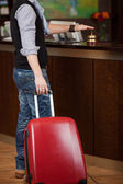 Customer With Baggage Ringing Bell At Reception Counter — Stock Photo