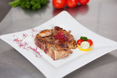 Garnished Meat In Plate On Kitchen Counter — Stock Photo