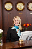 Smiling blond receptionist — Stock Photo