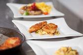 Garnished dishes on restaurant kitchen counter — Stock Photo