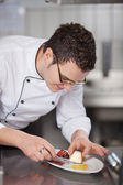 Chef Placing Icecream In Garnished Plate — Stock Photo