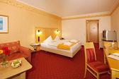 Simple Bedroom In Hotel — Stock Photo