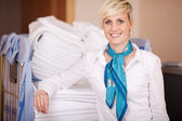 Smiling Female Housekeeper In Stock Room — Stock Photo