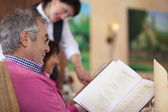 Guest in restaurant reading the menu — Stock Photo