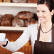 Serving coffee in a bakery — Stock Photo