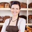 Owner of a bakery standing with folded arms — Stock Photo