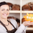 Smiling woman baker — Stock Photo