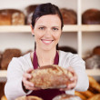 Friendly bakery assistant or worker — Foto Stock