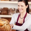 Woman working in a bakery — Stock Photo #26213755