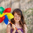 Girl Holding Colorful Pinwheel In Park — Stock Photo