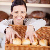 Worker sorting fresh rolls in a bakery — Stock Photo