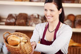 Woman working in a bakery — Stock Photo