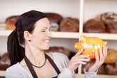 Woman with piggybank — Stock Photo