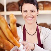 Smiling saleslady in a bakery — Stock Photo