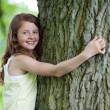 Happy Girl Embracing Tree In Park — Stock Photo