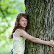 Concerned Girl Embracing Tree In Park — Stock Photo