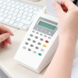 Dentist assistant with a payment terminal — Stock Photo #26229339