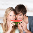 Stock Photo: Couple eating melon together
