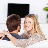 Smiling woman embracing her boyfriend — Stock Photo