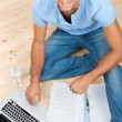 Young man learning at home — Stock Photo