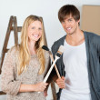 Couple crossing brushes — Stock Photo